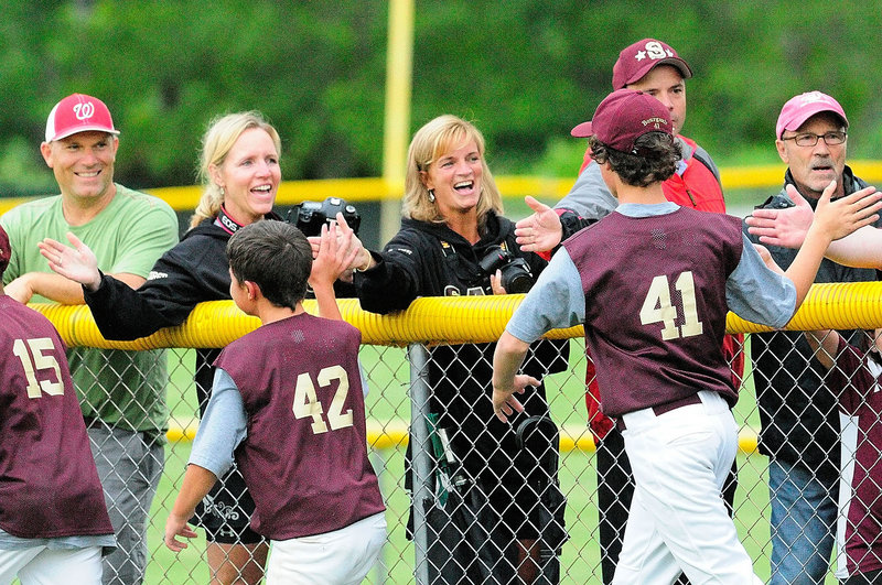 The Saco Little League players celebrated their state championship with their fans Friday night, slapping hands down the first-base line after defeating Bayside of Portland 14-1 in four innings in the final game. The teams split two earlier games this week.