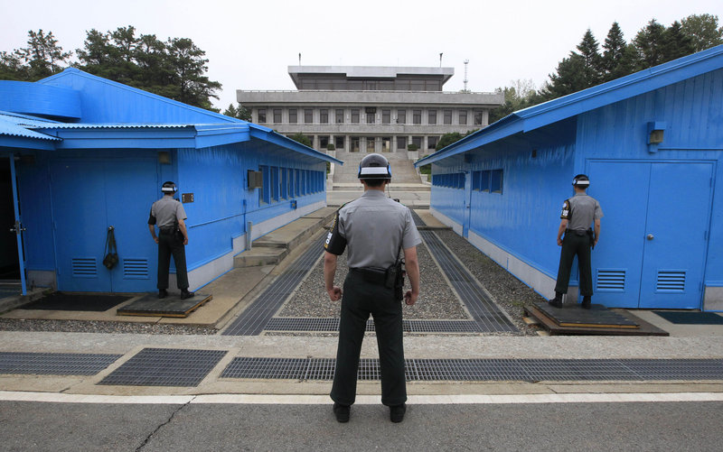 South Korean soldiers stand guard at the border village of Panmunjom, which has separated the two Koreas since the Korean War. The war has never officially ended, for which some officials in North Korea put blame on the United States.