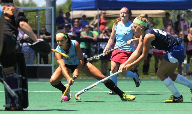 Kristy Bernatchez of Messalonskee tries to put a shot on goalie Patty Smith of Gorham while Sarah Sparks of Falmouth defends Saturday during the McNally Senior All-Star field hockey game. Bernatchez had a goal in the East's 3-0 victory.