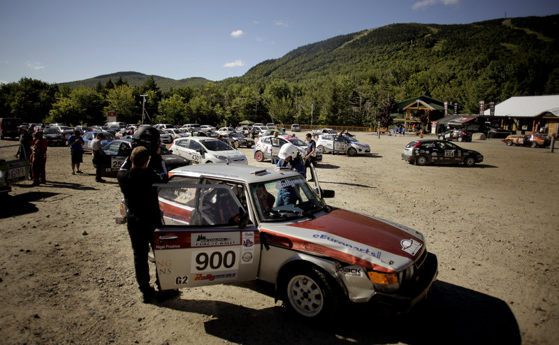 Mike White and Geoff Clark prepare to enter their Saab in the South Lodge parking lot at Sunday River on Saturday as they and other rally teams line up for the start of the second day of the New England Forest Rally.