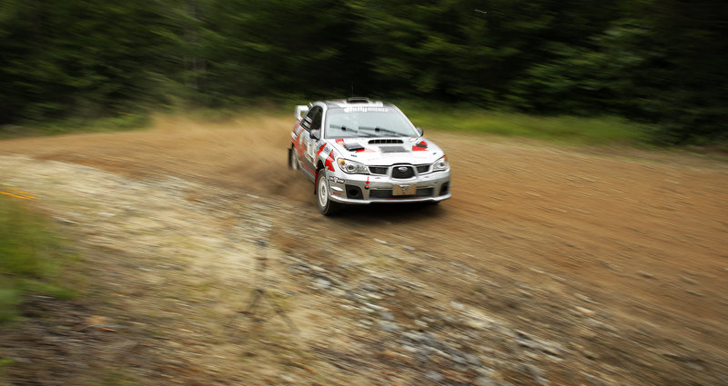 The Last Ditch Racing team of John Cassidy and Dave Getchell work their Subaru through the Concord Pond Stage of the 2013 New England Forest Rally in Newry on Friday. Driving competitively on loose surfaces is a dance performed at the edge of control.