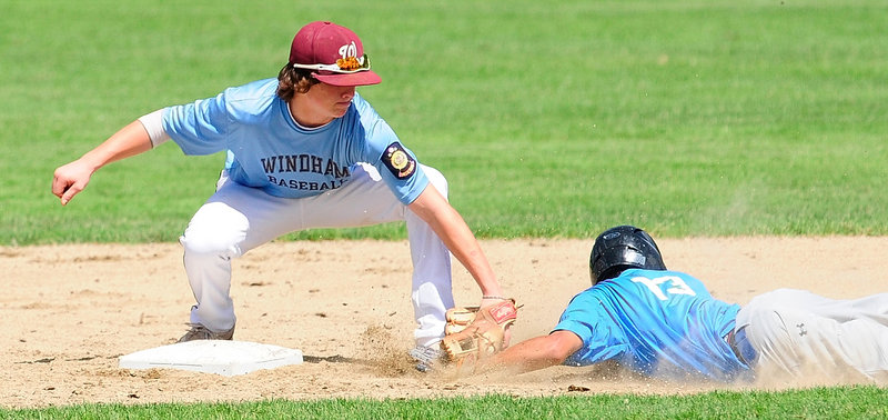 Second baseman Tanner Laberge of the Windham American Legion team tags Derek Leblanc of Madison during their state tournament play-in game Saturday. Windham won 12-4 and will meet Westbrook in the first round.