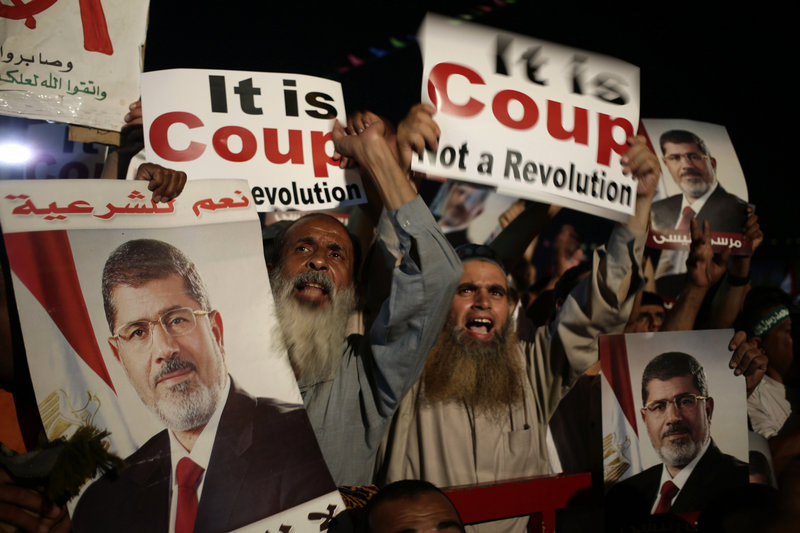 Supporters of ousted Eyptian President Mohammed Morsi chant slogans against Egyptian Defense Minister Gen. Abdel-Fattah el-Sissi in Nasr City on Sunday.