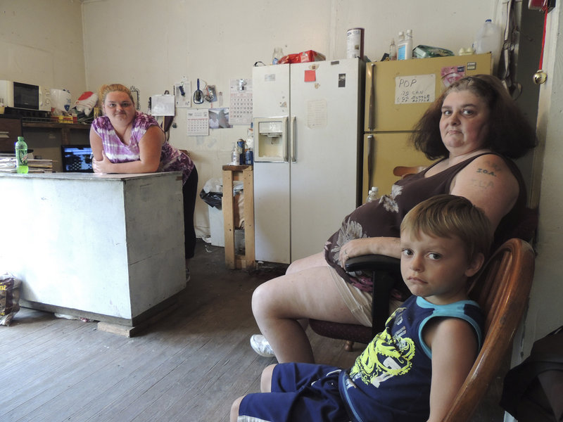 Renee Adams, left, poses with her mother, Irene Salyers, and son Joseph, 4, at their produce stand in Council, Va., where they're trying to make a living but still depend on public assistance.