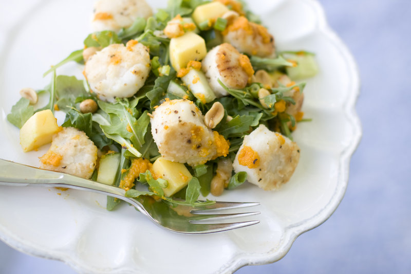 Warm scallops mix well with a carrot-ginger dressing, cucumber and mango in a salad.