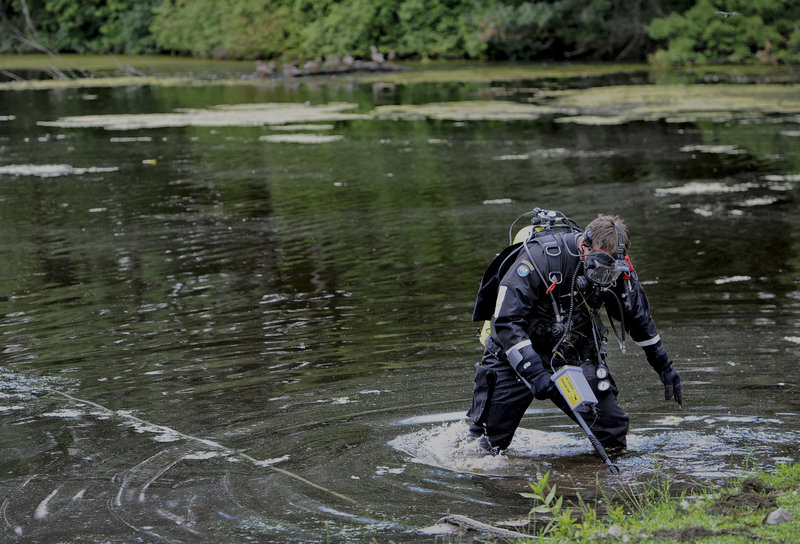 Connecticut State Police Dive Team search Pine Lake in Bristol, Conn., the hometown of the former New England Patriots player Aaron Hernandez, Monday, July 29, 2013. Hernandez has pleaded not guilty to murder in the death of Odin Lloyd, a 27-year-old Boston semi-professional football player. (AP Photo/Jessica Hill)