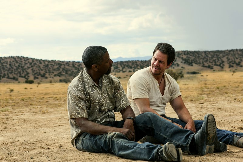 "Denzel Washington, left, and Mark Wahlberg try to outfox each other in""2 Guns."""