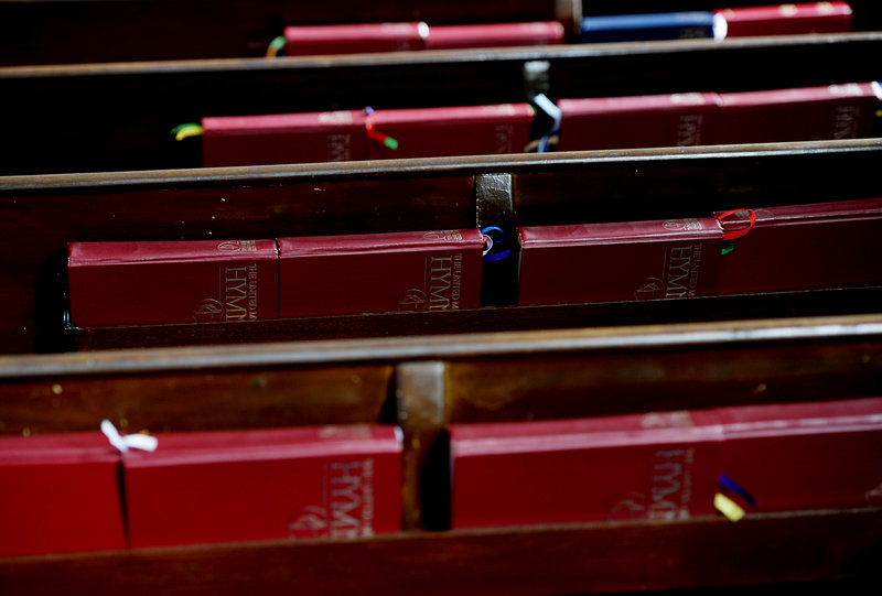 Hymnals line the backs of pews at First United Methodist Church.