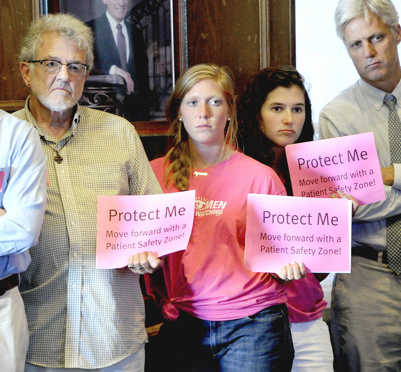 John Greenwood, R.N. from Kennebunk, Elizabeth Marcuse and Julia Springer, both from Cape Elizabeth were among the large crowd to attend Tuesday's meeting in support of a buffer zone to protect the clinic's patients.