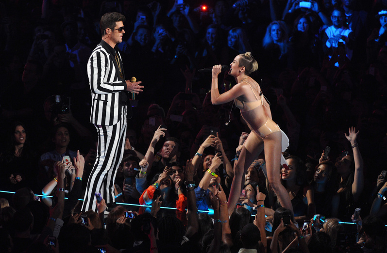 """Robin Thicke and Miley Cyrus, wearing a flesh-colored bikini, perform """"Blurred Lines"""" at the MTV Video Music Awards on Sunday in New York."""