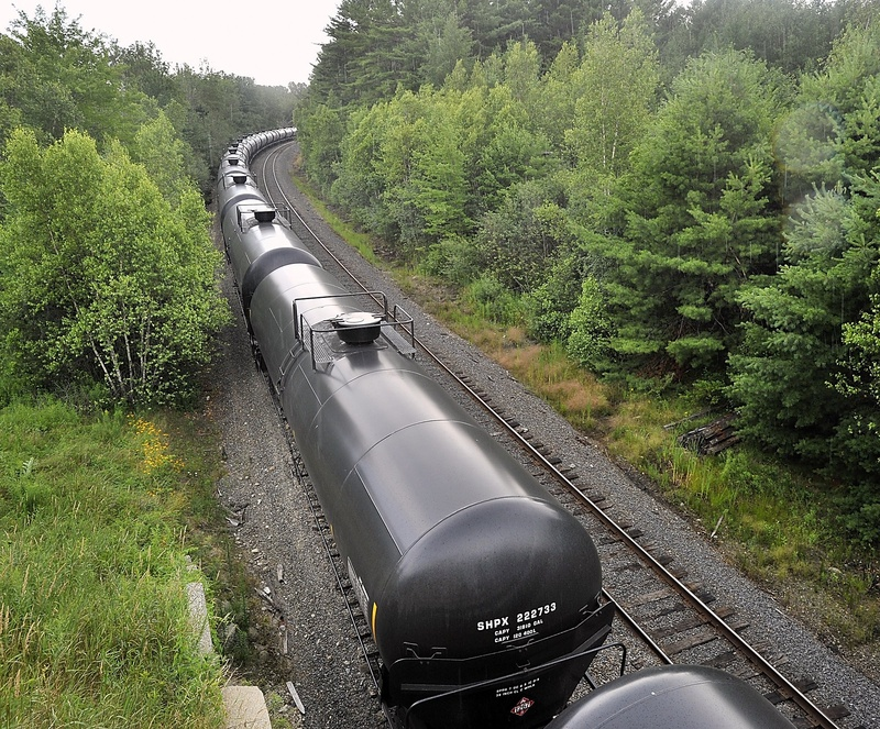 Petroleum transport rail cars sit on a siding near Route 115 in Yarmouth.