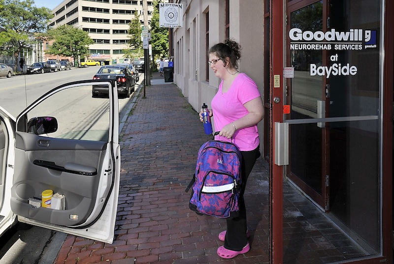 Rebecca Lee gets a ride home from her father from the Goodwill Neurorehab Services at Bayside after her regular MaineCare-funded ride failed to show because of a