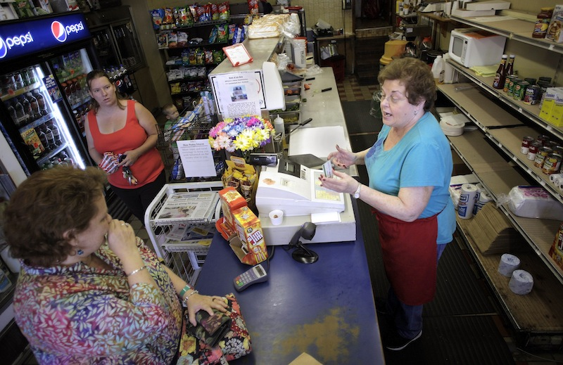 Eleanor DiPietro, at right, owner of DiPietro's Italian Sandwiches, chats with customer Ellen Deering, bottom left, during the dinner rush Thursday, August 8, 2013. The store will be closing its doors next Sunday, August 18, after generations in business.