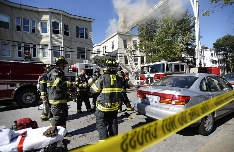 A two-alarm fire heavily damaged the top story of a three-story apartment building on Grant Street in Portland on Wednesday.