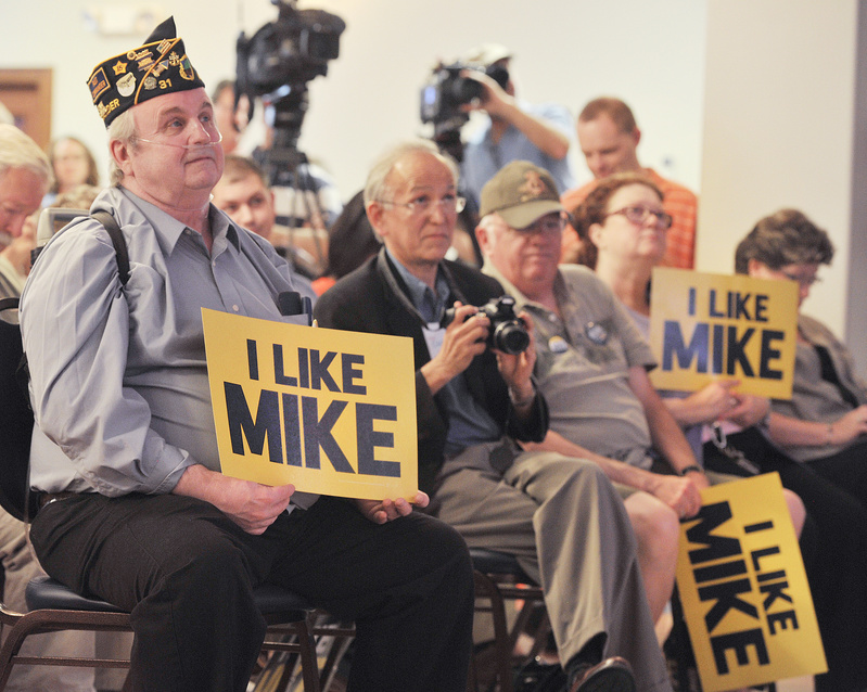 Phil Nelsen of Lewiston listens to U.S. Rep. Mike Michaud announce his candidacy for governor at the Franco-American Heritage Center in Lewiston on Thursday.