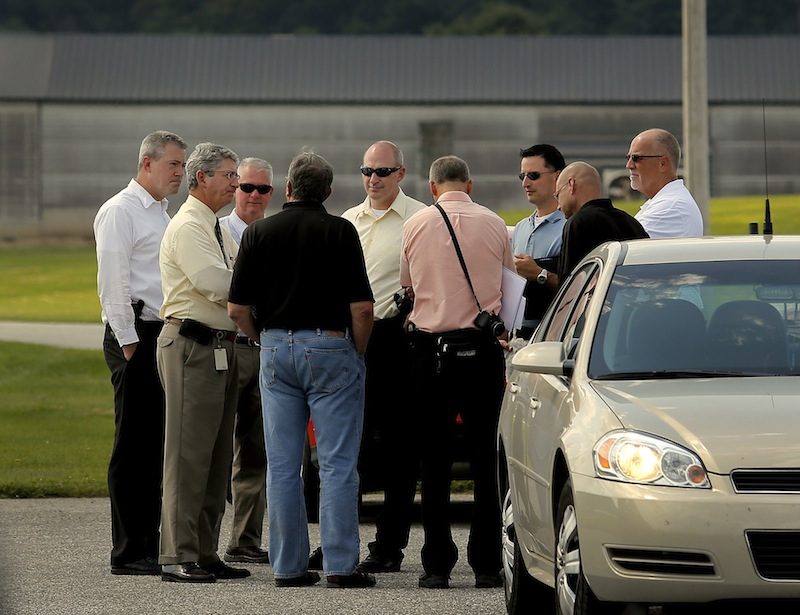 State police investigators and Deputy Attorney General William Stokes met with officials from Moark Egg Farm at its Turner location Tuesday, August 20, 2013, after a man was accidentally shot and killed by a contractor who was shooting rodents and stray chickens.