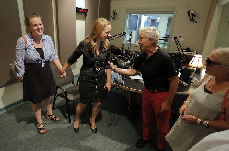 "Suzanne Nance, center, in black, shares a moment with friends Kate Cox, at left, and Frank and Sharon Reilly, at right, after Nance signed off of her last broadcast as host of ""Morning Classical"" on MPBN Friday, August 23, 2013."