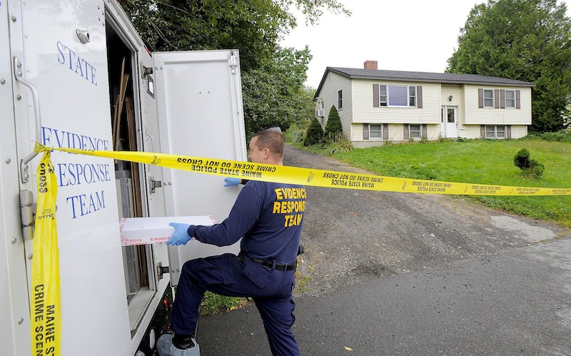 A state police evidence technician enters a state police mobile lab at 162 Waldo Ave. in Belfast on Thursday, Aug. 29, 2013. Belfast resident Todd Gilday had been charged with murdering Lynn Arsenault, 55, and wounding her son, Mathew Day, 21, at their home seen here.