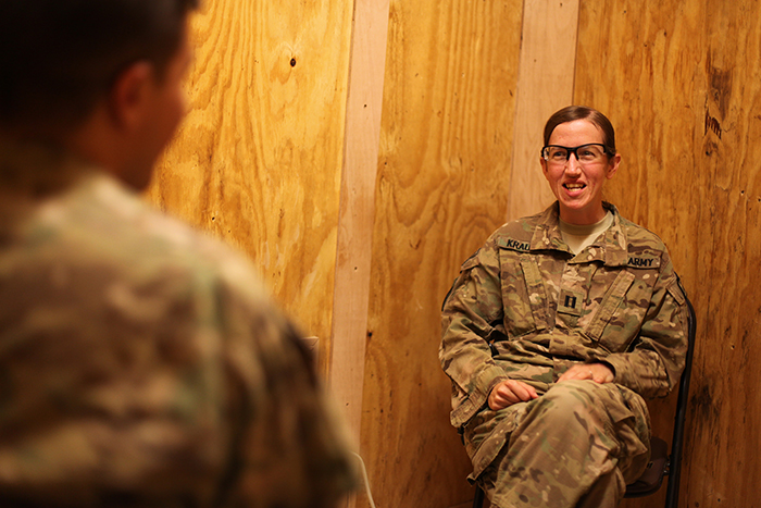 In Afghanistan, the most experienced soldiers, redeployed to do the job of wrapping up the U.S. mission, also are coping with high levels of post-traumatic stress. Capt. Stacey Krauss, a U.S. Army psychologist, speaks with a soldier this month at Forward Operating Base Arian, Afghanistan.