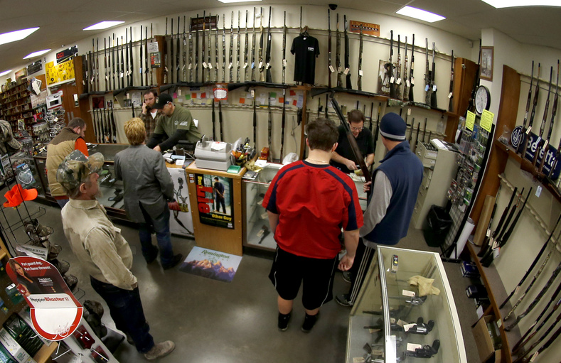 Customers line up at the gun counter at Duke's Sport Shop in New Castle, Pa. A new study finds that thousands of guns are being sold on the Internet, where buyers don't have to submit to a background check, as they would at retail stores.