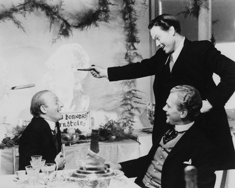 """Actor Orson Welles, standing, in a scene from the movie """"Citizen Kane,"""" the 1941 drama that he also directed and in which he demonstrated his immense talent. An earlier, silent film by Welles has been found."""