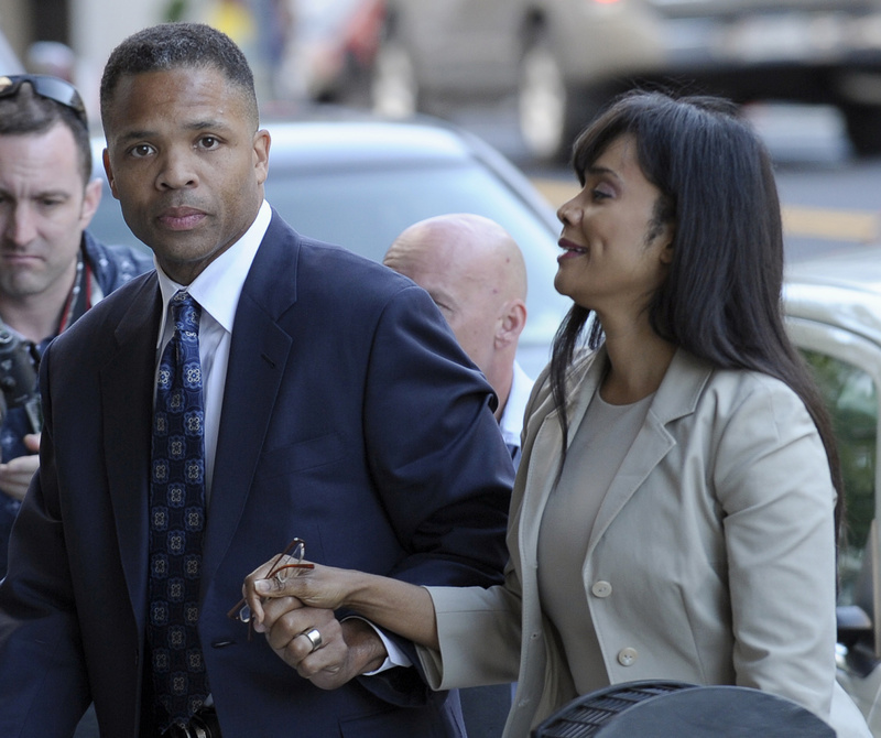 Former Illinois Rep. Jesse Jackson Jr. and his wife, Sandra, arrive at federal court in Washington on Wednesday.
