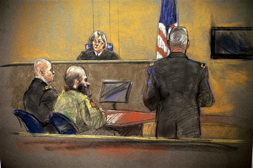 In this courtroom sketch, Maj. Nidal Hasan, center, sits before the judge, U.S. Army Col. Tara Osborn, during the sentencing phase of his trial in Fort Hood, Texas.