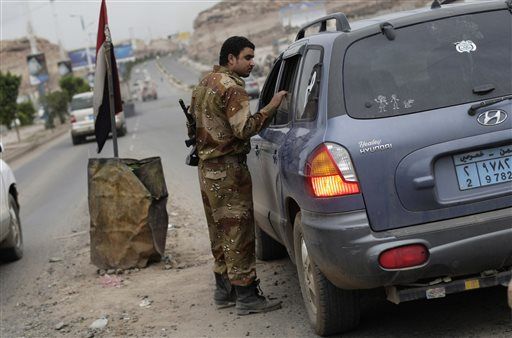A Yemeni soldier inspects a car at a checkpoint on a street leading to the U.S. embassy in Sanaa, Yemen, on Sunday. Security forces closed access roads, put up extra blast walls and beefed up patrols near U.S. diplomatic missions that Washington ordered closed for the weekend over a ``significant threat'' of an al-Qaida attack.