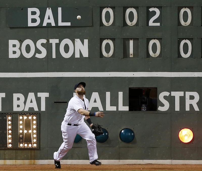 Boston's Jonny Gomes fields the one-run double off the wall by Baltimore's Chris Davis in the fifth inning Thursday.