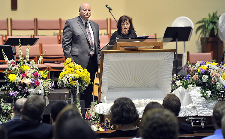Ashley Drew's mother, Joy Drew, thanks all who helped Ashley through her life as Ashley's father, Tom Drew, waits to share his memories of Ashley at A Celebration of Life for Ashley Drew on Friday.