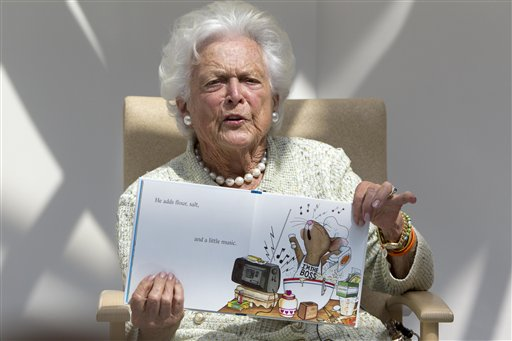 """Former first lady Barbara Bush reads """"The Best Mouse Cookie"""" by Laura Numeroff on Thursday at The Barbara Bush Children's Hospital at Maine Medical Center in Portland."""