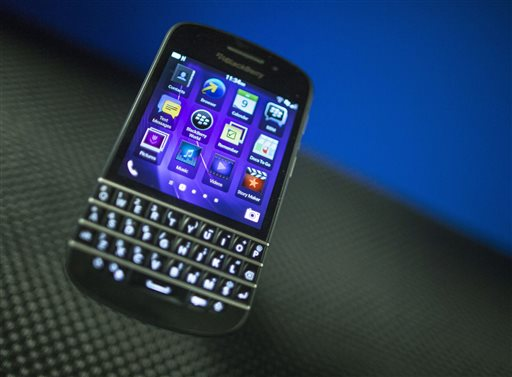 """A BlackBerry Q10 is displayed recently at a company' meeting, in Waterloo, Ontario. Struggling smartphone maker BlackBerry will consider selling itself. The Canadian company is exploring """"strategic alternatives"""" in hopes of boosting Q10 sales."""