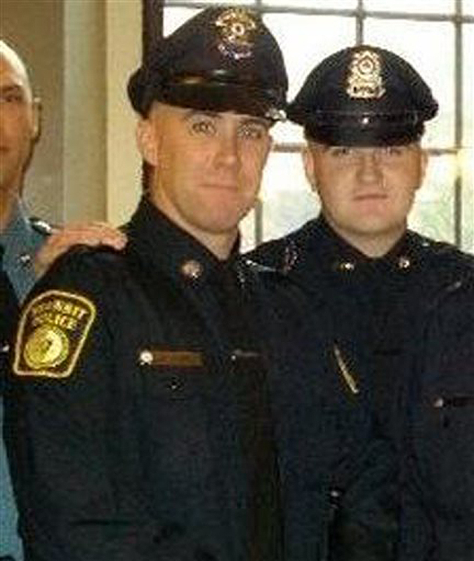 In this 2010 photo, Richard Donohue Jr., left, and Sean Collier pose for a photo at their graduation from the Municipal Police Officers' Academy. Collier, a Massachusetts Institute of Technology Police Officer, was fatally shot on the MIT campus, and transit police officer Donohue was shot and critically wounded, both allegedly by the Boston Marathon bombing suspect on the night of his capture.