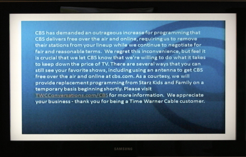 A television screen shows the CBS channel with an announcement by Time Warner Cable in Los Angeles on Friday. Three million Time Warner Cable customers in New York, Los Angeles and Dallas are losing the CBS channel, as the cable provider says it is dropping the network in a dispute over fees.