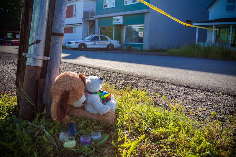 A memorial sits outside the Reptile Ocean exotic pet store in Campbellton, New Brunswick, Canada, on Tuesday, Aug. 6, 2013. Autopsies will be performed Tuesday on two young boys who were strangled in their sleep by a large African rock python that escaped from the pet store and slithered into the living room of an apartment upstairs from the pet store. (AP Photo/The Canadian Press, John LeBlanc)