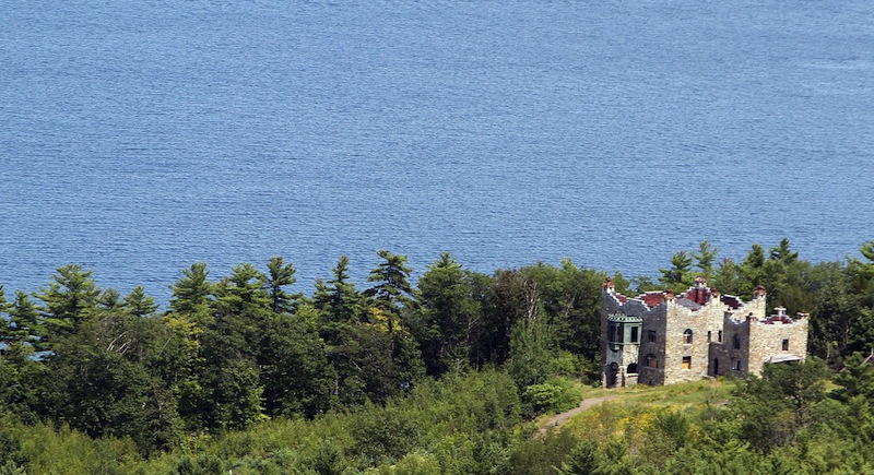 In this photo taken Wednesday Aug. 7, 2013 Kimball Castle is seen overlooking Lake Winnipesaukee in Gilford, N.H. It was built in the late 1890s for Benjamin Ames Kimball, who was president of the Boston-Montreal Railroad. The decrepit castle with commanding views of the lake is under the threat of a wrecking ball in its near future. (AP Photo/Jim Cole)