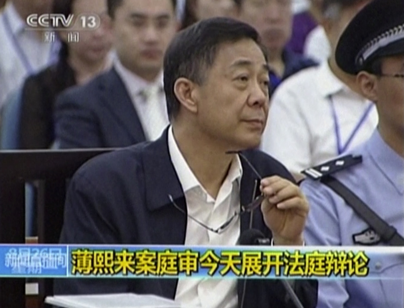 In this image taken from video, former Chinese politician Bo Xilai looks up in a courtroom at Jinan Intermediate People's Court in Jinan, eastern China's Shandong province, on Monday.