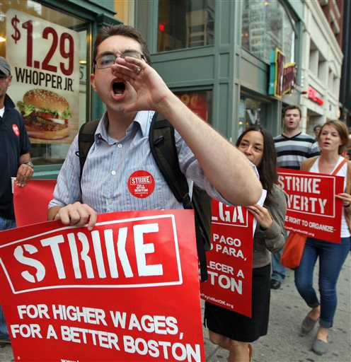 Protesters vocalize their demands for better pay in the fast-food industry Thursday outside a Boston Burger King.