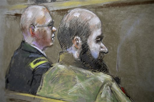 This courtroom sketch shows U.S. Army Maj. Nidal Malik Hasan, right, and his defense attorney, Lt. Col. Kris Poppe, are shown Wednesday in Fort Hood, Texas. Hasan is accused of killing 13 people and wounding more than 30 others at the Texas military base in November 2009.