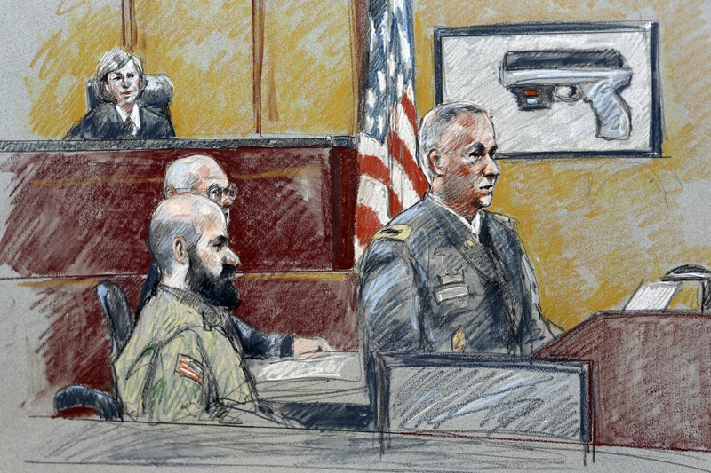 Military prosecutor Col. Steve Henricks, right, speaks as Nidal Malik Hasan, center, and presiding judge Col. Tara Osborn look on during Hasan's court-martial in Forth Hood, Texas.