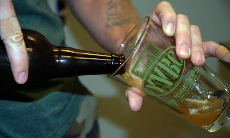 Thomas Wilder, Young Veterans Brewing Co. president and an Iraq War veteran, pours a glass of Jet Noise IPA at the Virginia Beach, Va., brewery.
