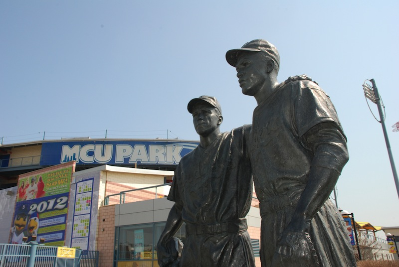 A statue of Pee Wee Reese and Jackie Robinson at MCU Park in the Coney Island section of the Brooklyn borough of New York. New York City police are investigating swastikas and hate speech scrawled on the statue outside Brooklyn's minor league baseball stadium. A manager at MCU Park noticed the defacement Wednesday morning, Aug. 7, 2013. (AP Photo/Brooklyn Cyclones)