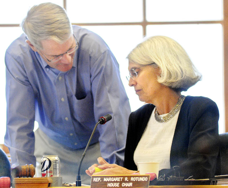 Sen. Patrick Flood, R-Winthrop, confers with Rep. Peggy Rotundo, D-Lewiston, during a meeting of the Legislature's Appropriations Committee Tuesday in Augusta.