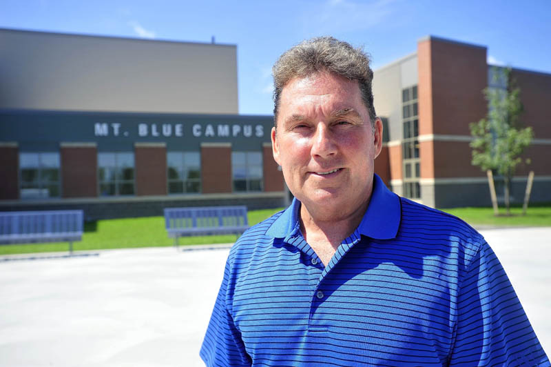 Tom Ward, superintendent of the Mt. Blue School District, stands outside the front entrance to the newly renovated Mt. Blue Learning Campus on Seamon Road in Farmington today.