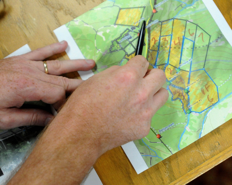 Lt. Kevin Adam, with the Maine Warden Service, points to a map to illustrate to reporters where searches are taking place to find missing Appalachian Trail thru-hiker Geraldine Largay, 66, at the Sugarloaf Mountain Hotel conference center in Carrabassett Valley today.