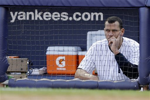 In this Oct. 14, 2012, photo, New York Yankees' Alex Rodriguez sits in the dugout after striking out in Game 2 of the American League championship series against the Detroit Tigers in New York.