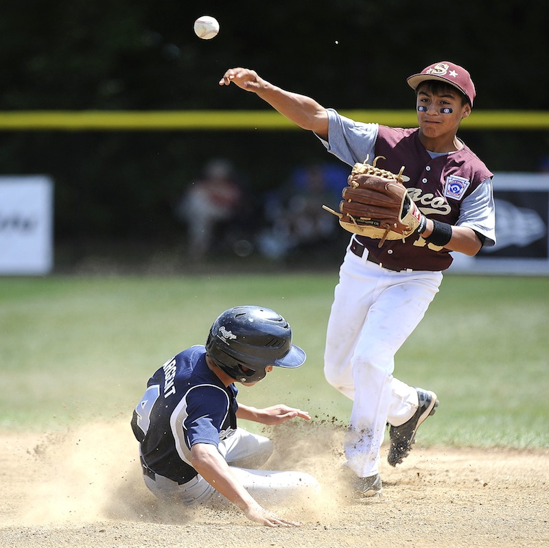 South Burlington Vermont's Ryan Sargent (4) is forced out at second by Saco Maine's Anthony Bracamonte (15) during the 2013 Eastern Regional Little League Tournament at Breen Field in Bristol on Tuesday. Despite a 1-3 record in pool play, the Saco Little League team has advanced to the semifinals.