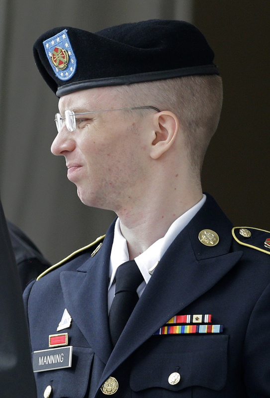 Army Pfc. Bradley Manning is escorted to a security vehicle outside a courthouse in Fort Meade, Md., on Friday after a hearing in his court martial.