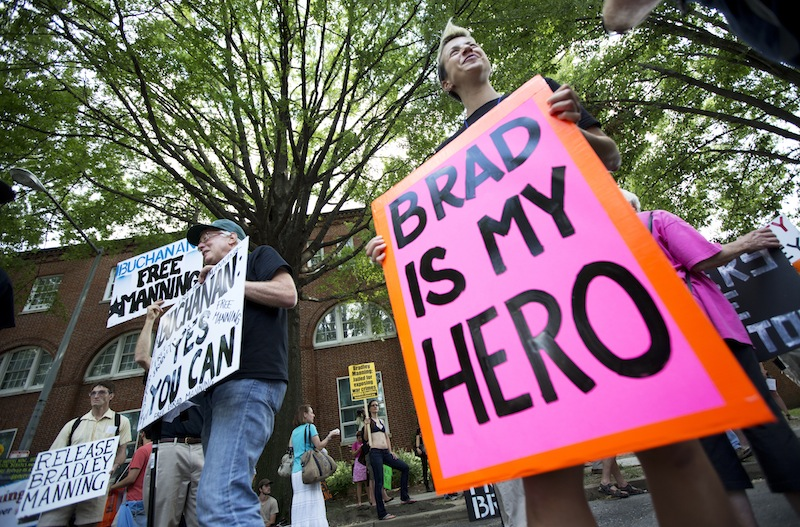 Heike Schotten of Cambridge, Mass., right, joins supporters of U.S. Army Pfc. Bradley Manning at a rally last month outside Fort Lesley J. McNair in Washington, D.C. On Wednesday, Manning was sentenced to 35 years in prison for leaking classified information.