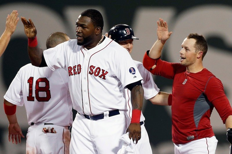 Boston Red Sox's Daniel Nava, right, celebrates his RBI single that drove in the winning run in the ninth inning of a baseball game against the Seattle Mariners in Boston, Thursday, Aug. 1, 2013. The Red Sox won 8-7. (AP Photo/Michael Dwyer)